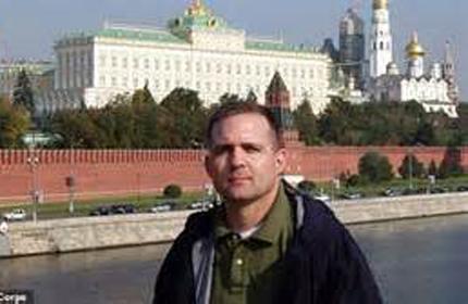 原料图片:前美海军陆战队员保罗·惠兰在克林姆林宫前留影。(图片来源于网络)
